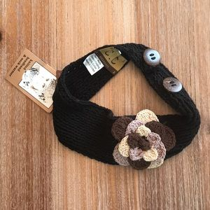Black knitted headband with flower